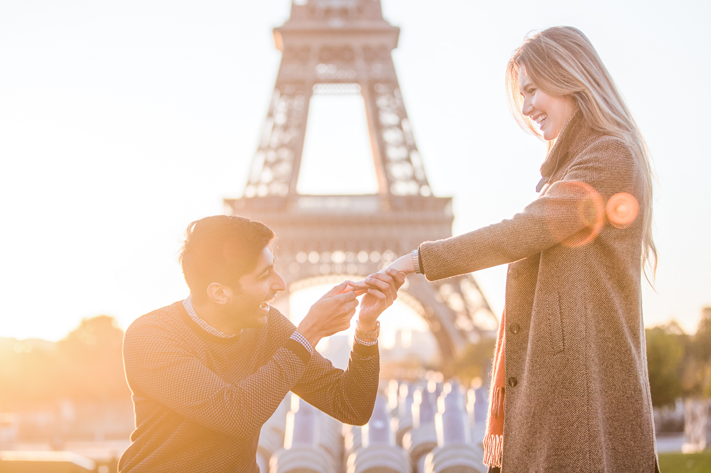 couple proposing at sunrise in front of Eiffel Tower
