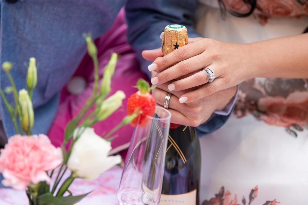 Anniversary photo shoot in Paris with Champagne and flowers