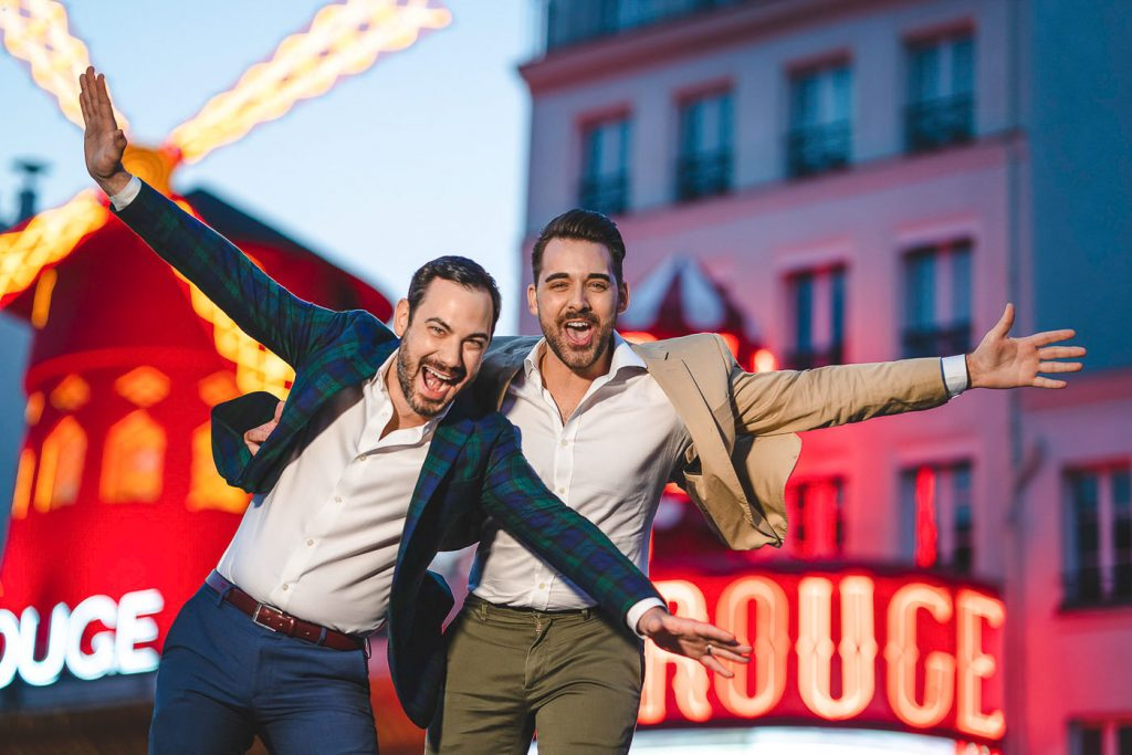 Same sex couple photo at Moulin Rouge Paris at night