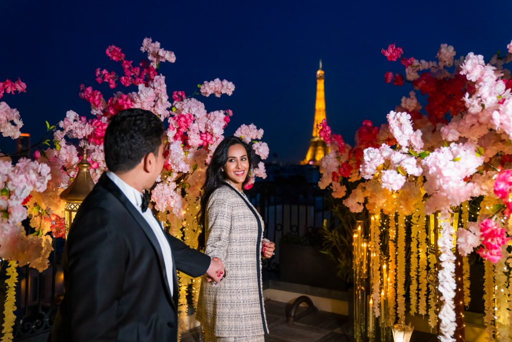 Dreamy Eiffel Tower couple photos at night on the Peninsula roof