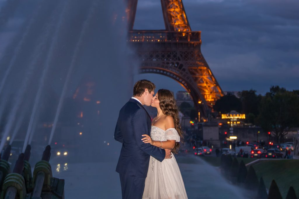 Eiffel Tower couple photos at night with Eiffel Tower lit up