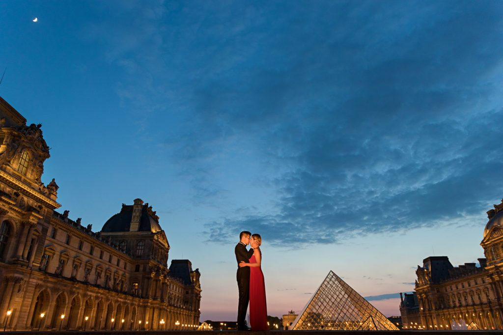 Famous Louvre Couple photo taken at the Pyramid during Blue Hour
