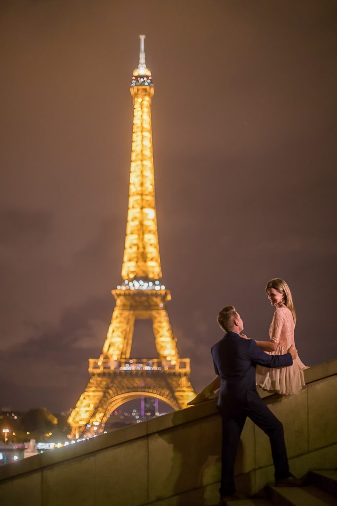 Nighttime Eiffel Tower engagement photo with Tower lit up