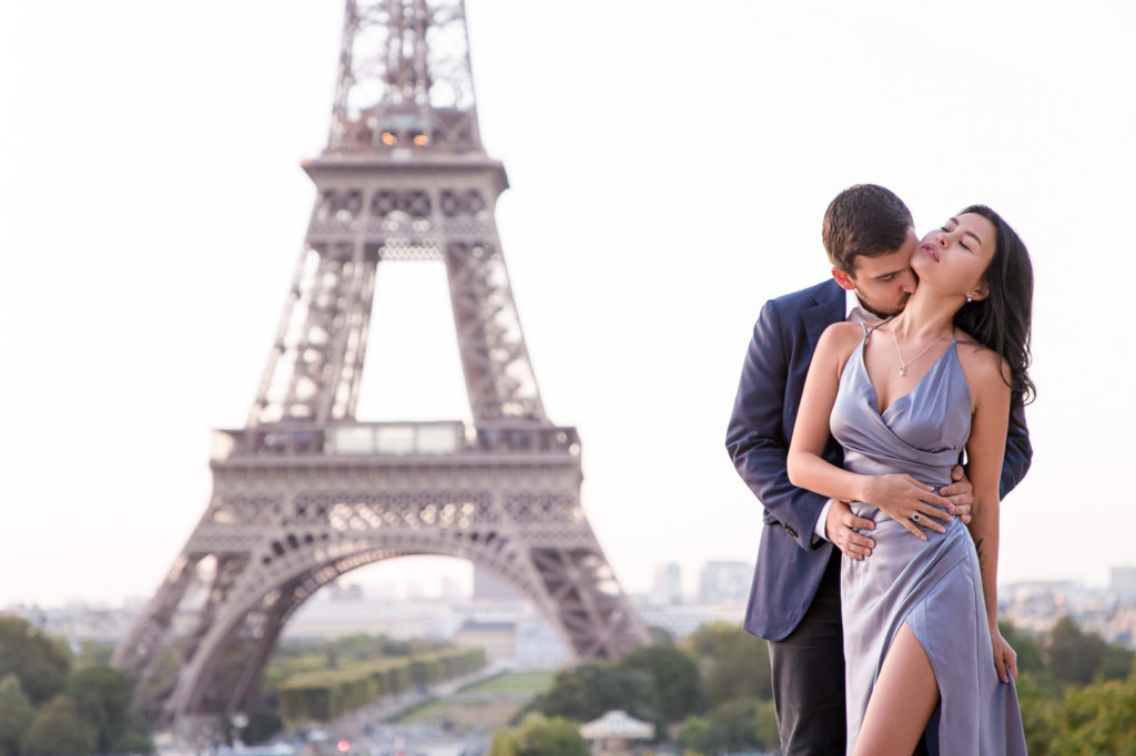 Sexy couple Eiffel Tower engagement photo taken at Trocadero at sunrise