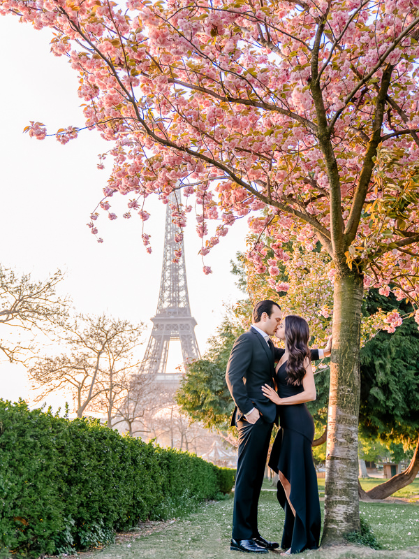 Paris engagement photos at the Eiffel Tower with Cherry Blossoms in bloom