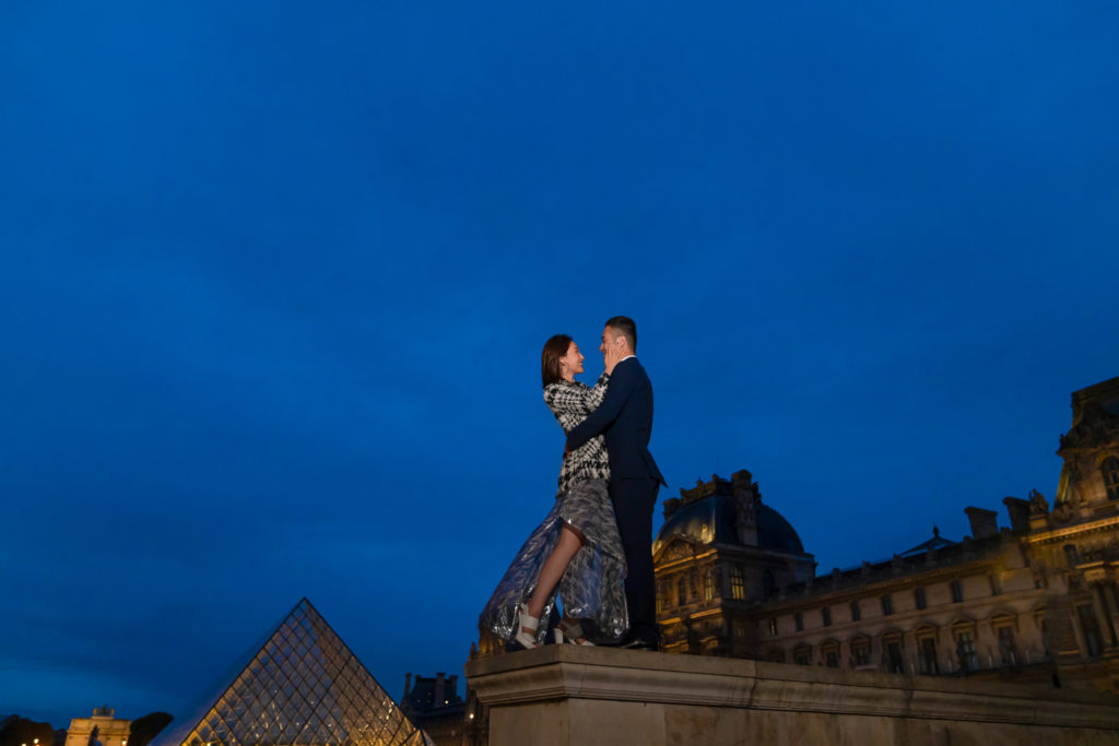 Couple engagement photos at the Louvre during the magical Blue Hour