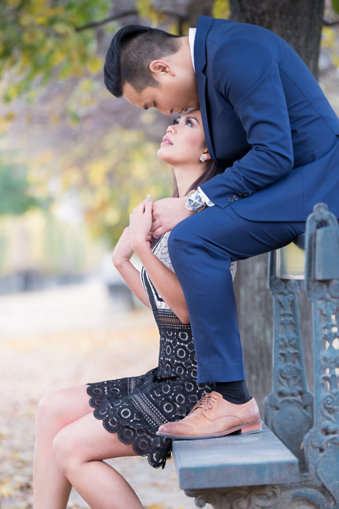 Intimate Paris engagement photos in the Tuileries Gardens on a bench