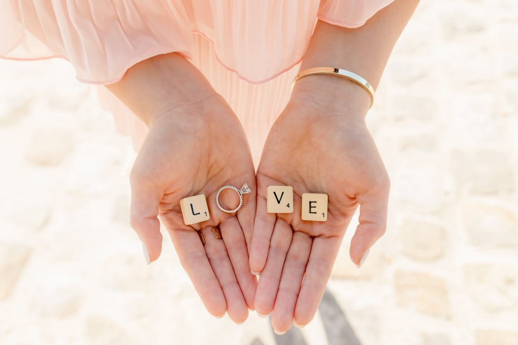 Creative engagement photos that show the diamond ring with LOVE