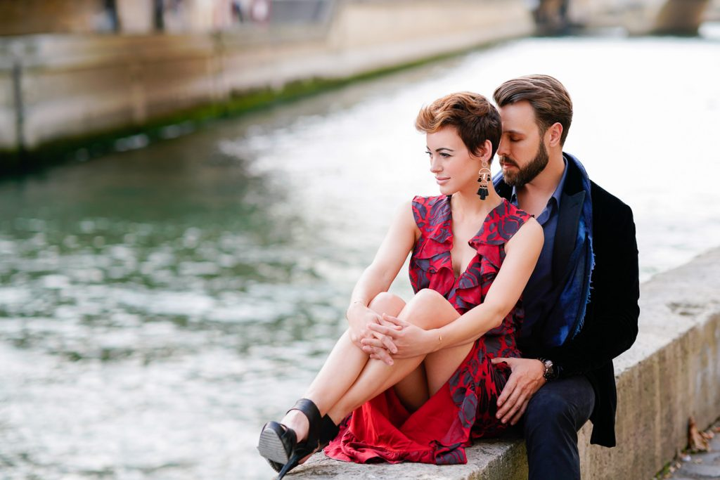 Romantic photo of couple connecting down by the Seine near Notre Dame