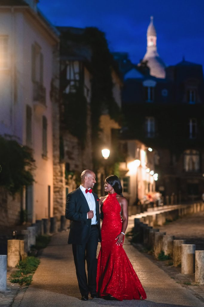 Black couple taking a romantic stroll through Montmartre during