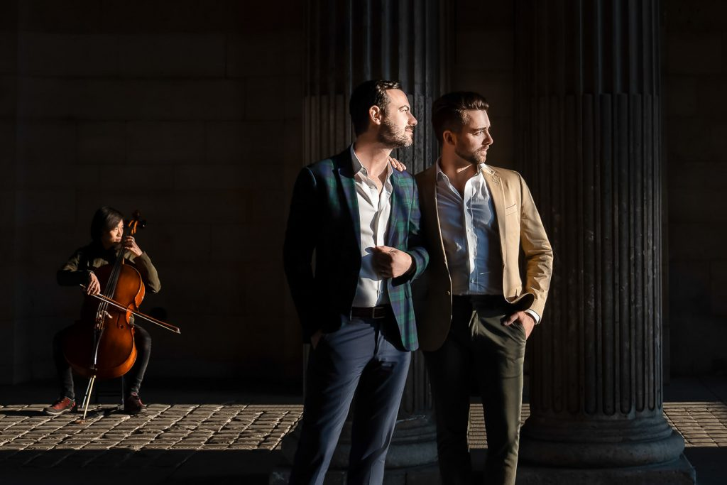 Award-winning Paris engagement photo with same-sex couple and violinist