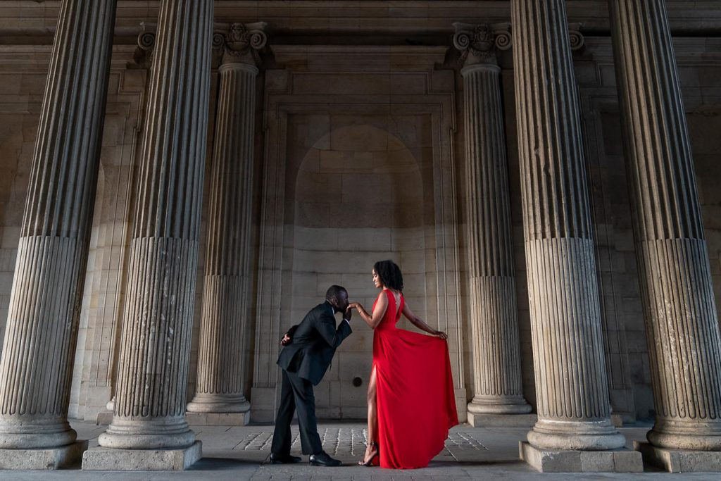 Red dress for paris engagement photos at the Louvre Museum