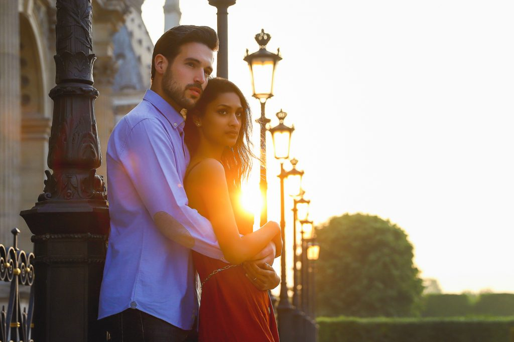 couple photos in Paris at sunset near the Louvre Museum