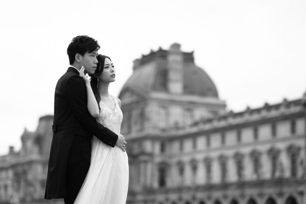 Romantic pre-wedding couple photoshoot pose at the Louvre Museum