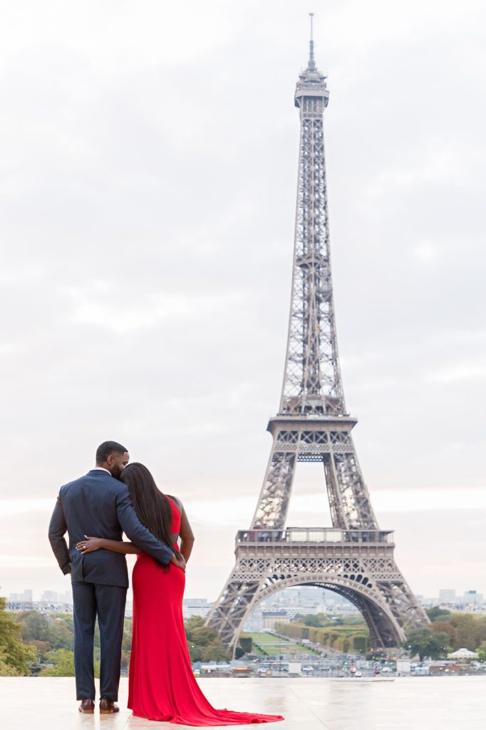 Super iconic black couple photo in Paris with Eiffel Tower view taken at Trocadero during sunrise