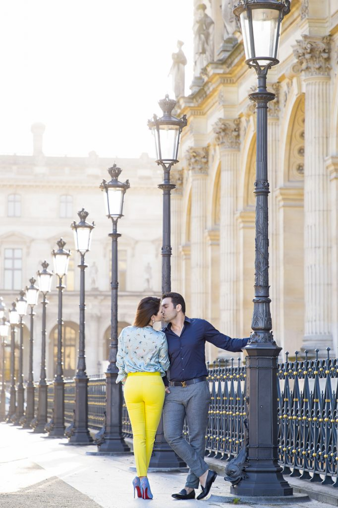 Sexy couple photoshoot pose at the Louvre Museum around sunrise